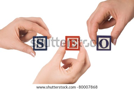 Hand and word SEO isolated on white background - stock photo