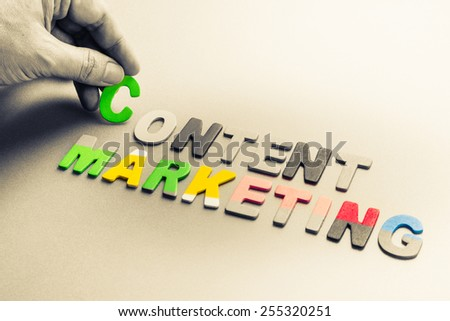 Hand arrange small wood letters as Content Marketing topic - stock photo