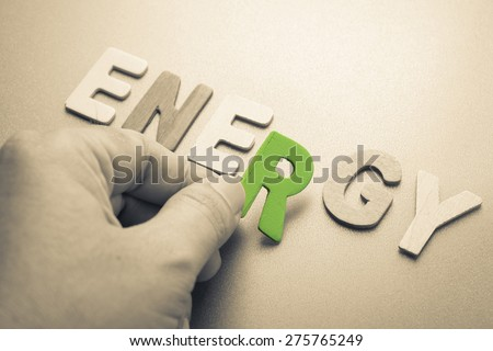 Hand arrange wood letters as Energy word - stock photo