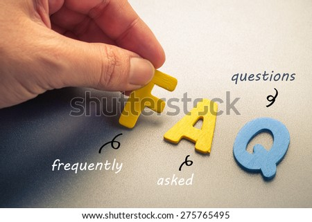 Hand arrange wood letters as FAQ abbreviation ( frequently asked questions ) - stock photo