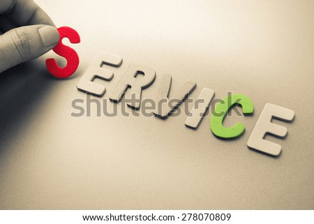 Hand arrange wood letters as Service word - stock photo