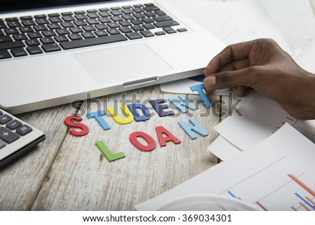 Hand arrange wood letters as student Loan word  - stock photo