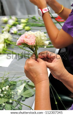 Hand Arranging Flower At school - stock photo