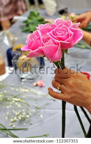 Hand Arranging Flower At school - stock photo