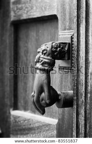 hand as a knocker on the door black and white - stock photo