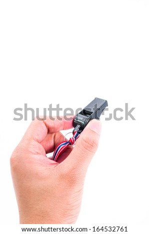 hand as action of put the black whistle on white background - stock photo
