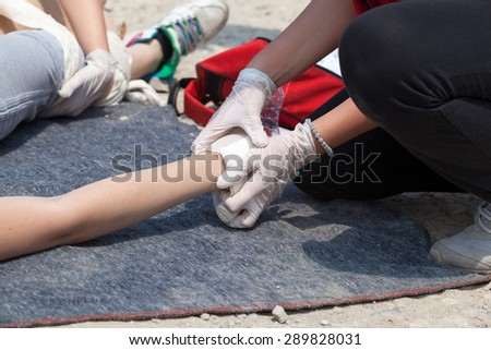 Hand bandaging. First aid. - stock photo