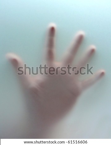 Hand behind transparent curtain