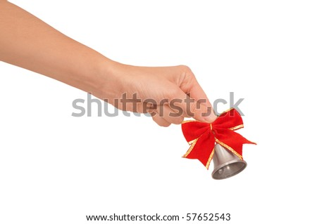 hand bell in the woman's hand for ringing