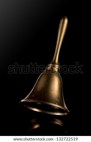 Hand Bell isolated on a black background - stock photo