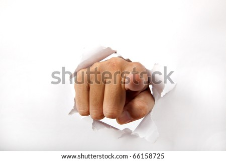 hand break through the white paper with finger pointing to the you - stock photo