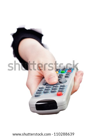 Hand breaking white paper surface holding remote control - stock photo