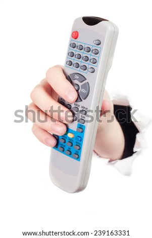 Hand breaking white paper surface holding remote control