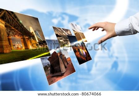 hand browsing photos - stock photo