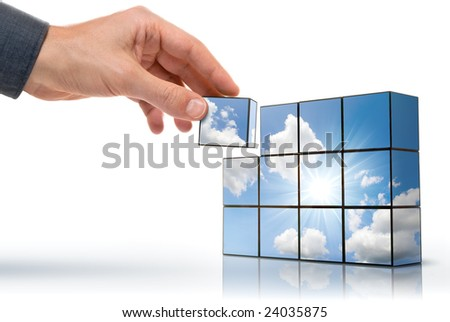 hand building up a sunny sky with white clouds - stock photo