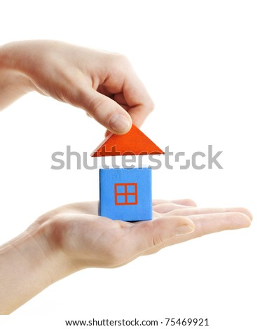 Hand building wooden block toy house isolated on white background - stock photo