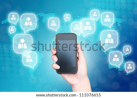hand business man touch smart phone in hand on blue technology background