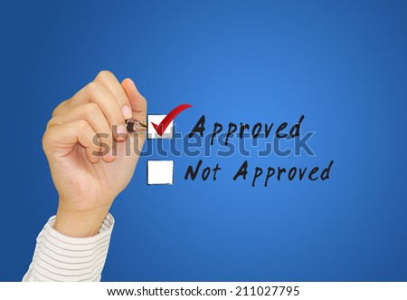 Hand businessman checking mark on checklist with marker.  - stock photo