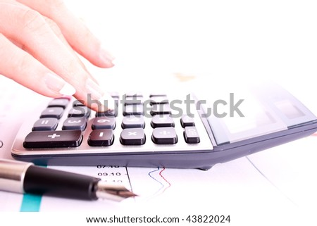 Hand, calculator and pen