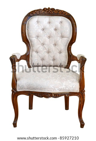Hand carved antique arm chair with clipping path on white background - stock photo