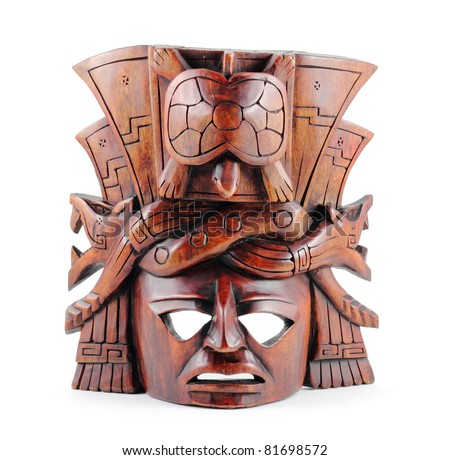 Hand-carved wooden Mayan mask isolated on a white background. - stock photo