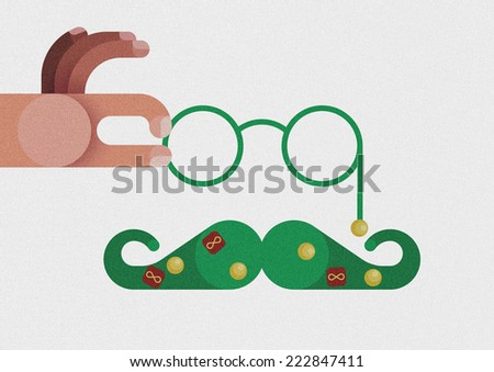 Hand catch glasses and mustache decorated by Christmas concept  - stock photo