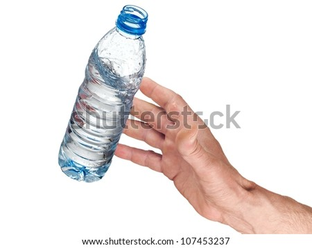 Hand catching a flying water bottle