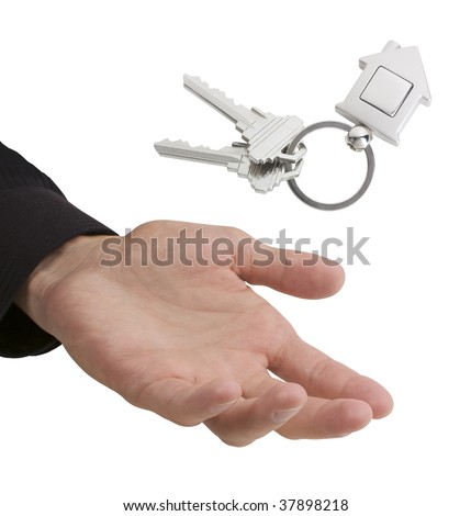 Hand catching or tossing keys with house-shaped fob, with space for your logo or graphic - stock photo
