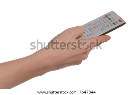 Hand changing a channel with a remote controller over white background. - stock photo