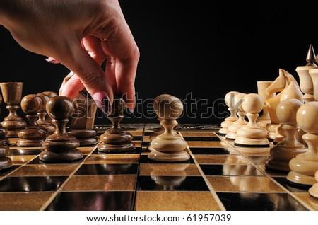 Hand chess move pawn - stock photo