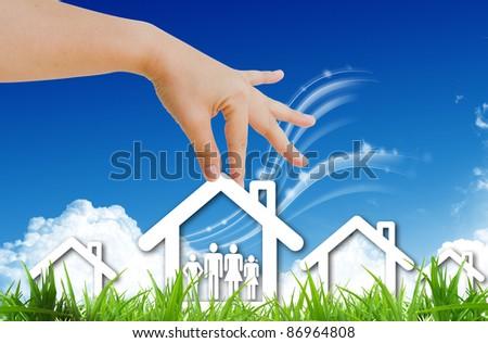 hand choosing home symbol - stock photo