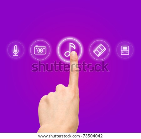 Hand choosing melody-sound film symbol from media icons - stock photo