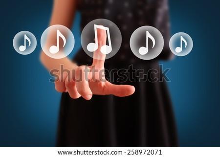 hand choosing music note symbol - stock photo