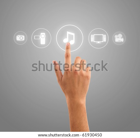 hand choosing music note symbol from media icons - stock photo