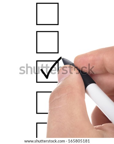 Hand choosing one of three options