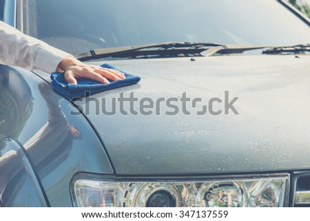 Hand cleaning car with microfiber cloth,wipe outside