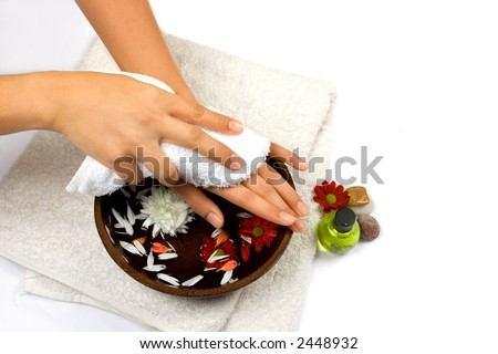 Hand cleansing as part of beauty and healthcare setting suitable for self pampering or spa, isolated with copyspace. - stock photo