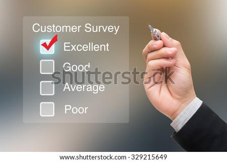 Hand clicking customer survey on virtual screen - stock photo