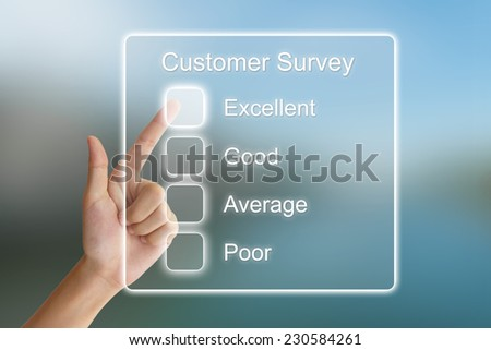 hand clicking customer survey on virtual screen interface  - stock photo