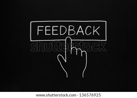 Hand clicking Feedback button drawn with white chalk on blackboard. - stock photo