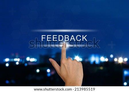 hand clicking feedback button on a touch screen interface  - stock photo