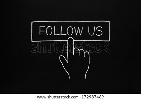 Hand clicking Follow Us button drawn with white chalk on blackboard. - stock photo
