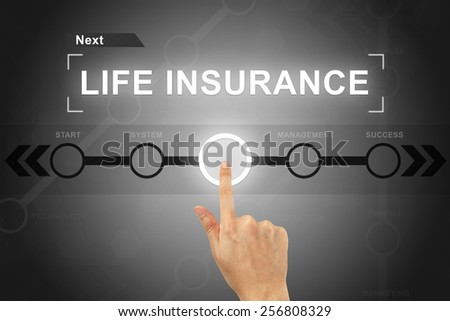 hand clicking life insurance button on a touch screen - stock photo