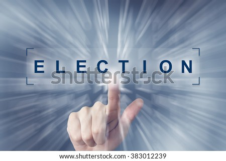 hand clicking on election button with zoom effect background - stock photo