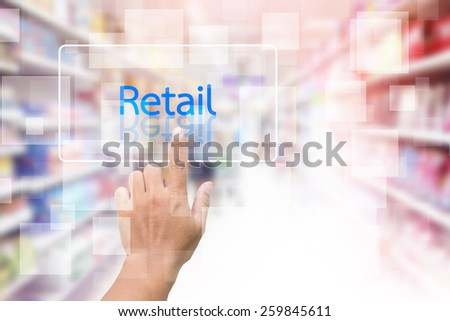 Hand Clicking On Retail Screen With Supermarket Shelves Blurred Background - stock photo