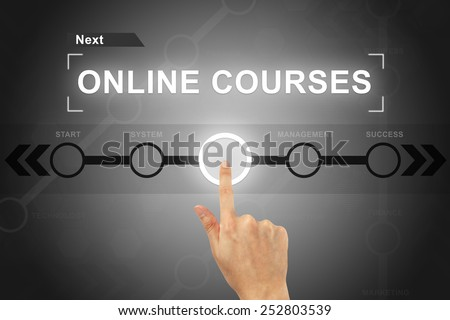 hand clicking online courses button on a touch screen - stock photo