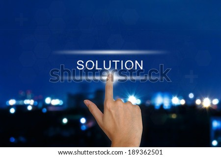 hand clicking solution button on a touch screen interface  - stock photo
