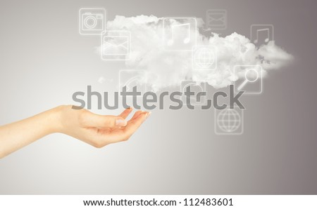 Hand, cloud and multimedia icons. Cloud computing concept - world wide data sharing and communication - stock photo