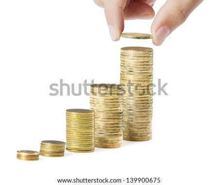 hand coins in finger and row stacks them isolated on white background