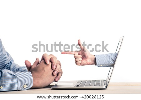Hand coming out of laptop screen - stock photo